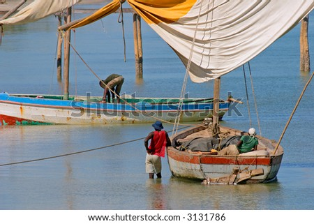 Fishermen and their traditional sail boats (dhows), Vilanculos coastal sanctuary, Mozambique - stock photo