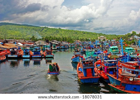 Fishermen boats in a river on Phu Quoc Island, Vietnam - stock photo