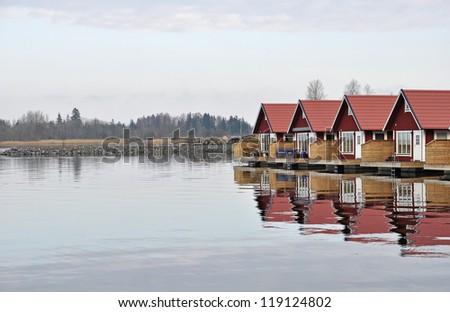 Fishermen huts at scandinavian coast - stock photo