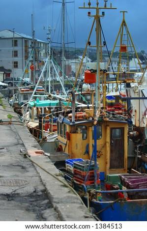 Fishermen in dock - stock photo