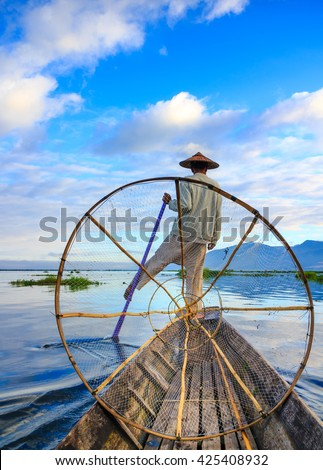 Fishermen in Inle Lake at sunrise, Inle, Shan State, Myanmar - stock photo