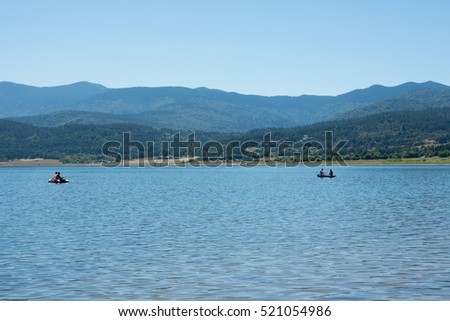 Fishermen in the lake