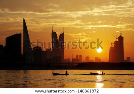 Fishermen returning back during sunset - stock photo