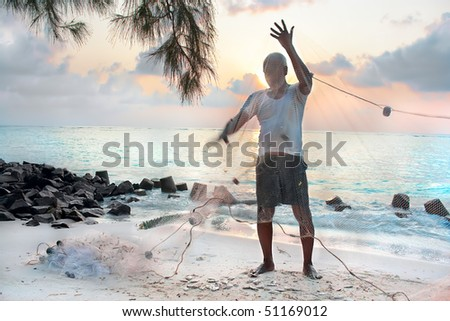 Fishermen with net in the early morning on tropical beach , India