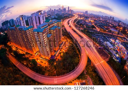 Fisheye Lens view of Kuala Lumpur City skyline during sunset at Malaysia, Asia - stock photo