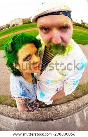 Fisheye portrait of man and women during holi festival - stock photo