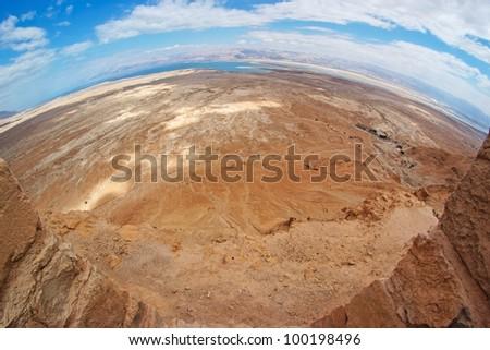 Fisheye view of desert landscape near the Dead Sea seen from Masada fortress - stock photo
