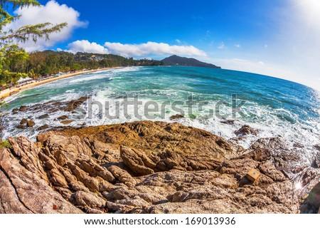 fisheye view on beach with blue sky and sun  - stock photo