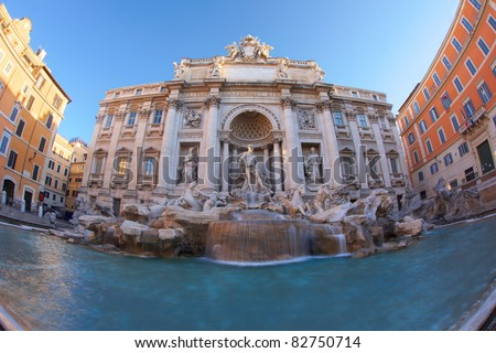 Fisheye view on the trevi fountain in Rome,capital of Italy, showing the whole monument in one shot at dawn - stock photo