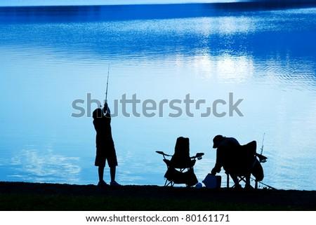 Fishing at Daybreak - stock photo