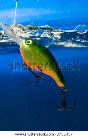 fishing bait underwater in a blue clear water - stock photo
