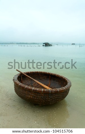 fishing basket on the river bank - stock photo