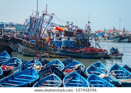 Fishing blue boats in Essaouira harbour with fishmens. September 2, 2012 in Essaouira, Morocco, Africa