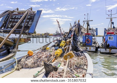 Fishing boat and fishing nets in the harbor