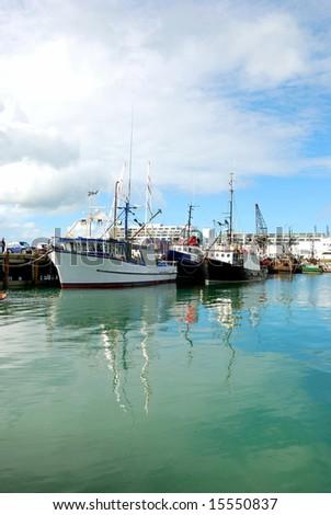 fishing boat at harbor - stock photo