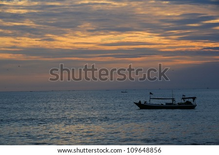 Fishing boat at sunset in Bali, Indonesia
