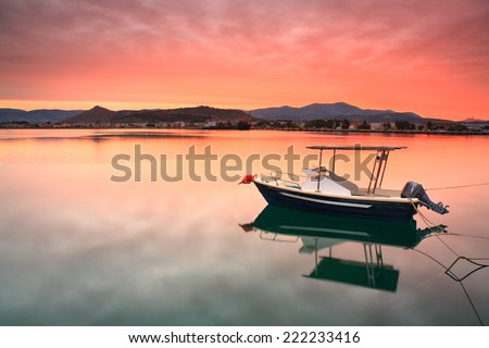 Fishing boat at sunset in Nafplio harbour, Greece.