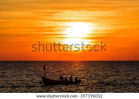 Fishing boat at sunset.India, Goa. - stock photo