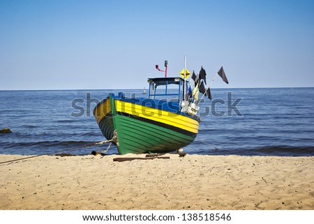 fishing boat at the beach of baltic sea