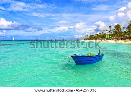 Fishing boat at the sea coast of the Dominican Republic. Blue fishing boat.