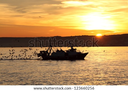 Fishing boat coming back home. Estepona, Costa del Sol, Andalusia, Spain - stock photo