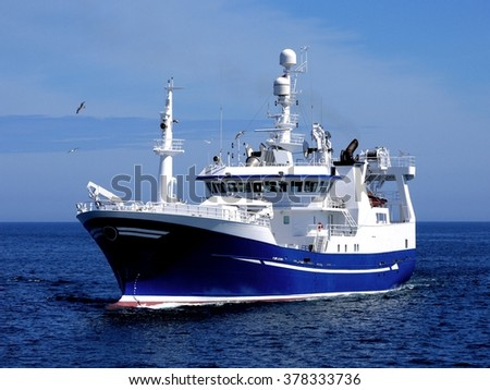 Fishing Boat, Fishing Vessel underway to fishing harbour to land fish. - stock photo