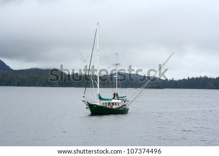 Fishing boat heading out to open water - stock photo