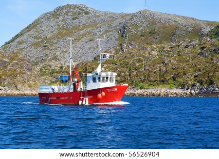 Fishing boat in a fjord of northern Norway - stock photo