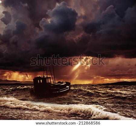 Fishing boat in a stormy sea  - stock photo