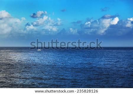 fishing boat in calm sea - stock photo