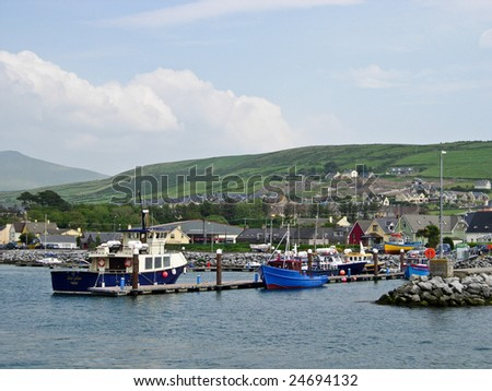 Fishing boat in Dingle harbour in Ireland - stock photo
