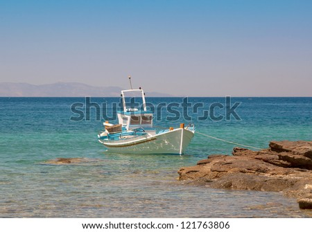 Fishing boat in Greece  near the beach. - stock photo