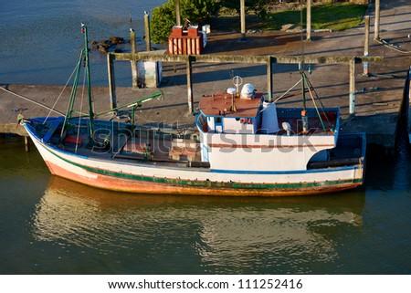 Fishing boat in Itajai port. Brazil. - stock photo