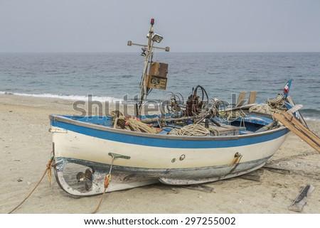 Fishing boat in Noli an Italian town in the region of Liguria - stock photo