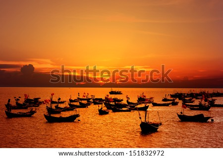 Fishing boat in Sunset over the sea.  - stock photo