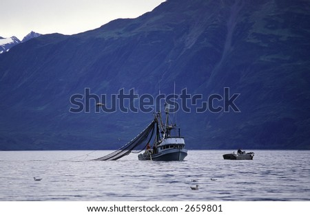 Fishing boat in the bay. - stock photo