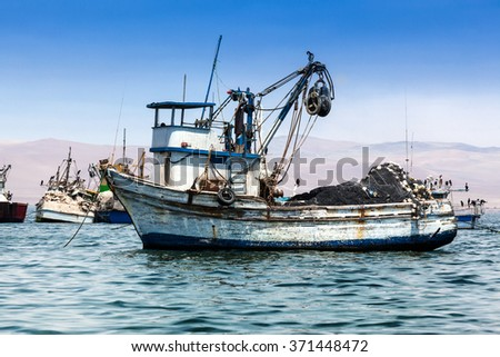 fishing boat in the bay of the Pacific Ocean - stock photo