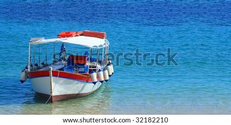 Fishing boat in the Ionian sea in Greece - stock photo
