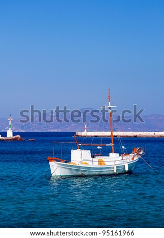 Fishing boat in the marine bay on the island of Mykonos in Greece - stock photo