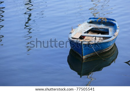Fishing boat in the sea in Greece - stock photo