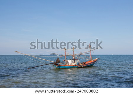 fishing boat in the sea seeing a detail of tool for fishing - stock photo