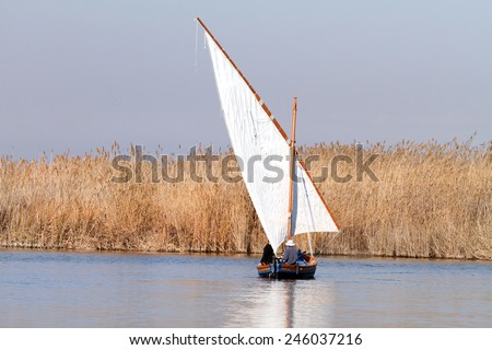 Fishing boat, La Albufera nature reserve, El Palmar, Valencia, Comunidad Valenciana, Spain.  - stock photo