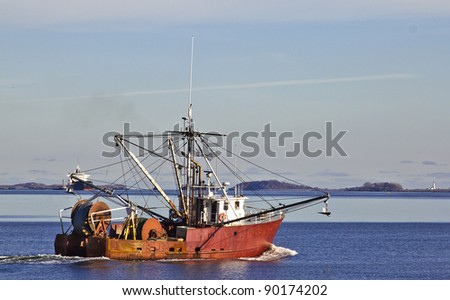 Fishing boat leaving the Boston Harbor - stock photo