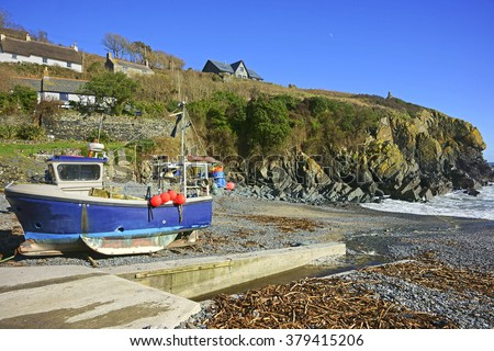 Fishing boat moored on the slipway and beach at Cadgwith Cove in Cornwall, UK - stock photo