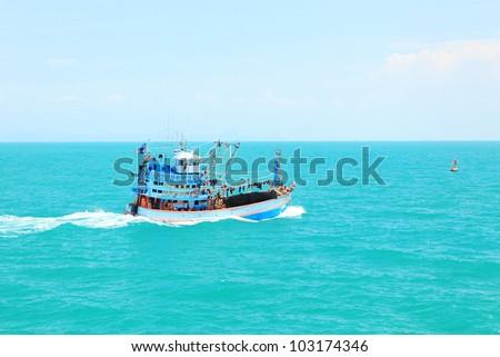 Fishing boat moving at open sea, Koh samui Thai gulf . - stock photo
