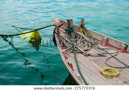 fishing boat on a calm sea. - stock photo