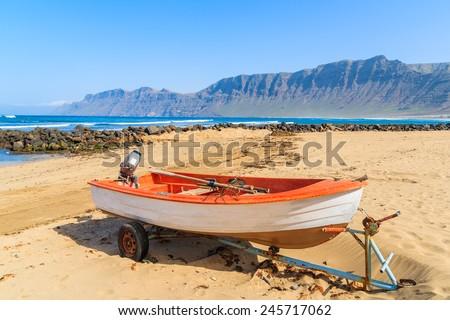 Fishing boat on Famara beach, Lanzarote, Canary Islands, Spain - stock photo