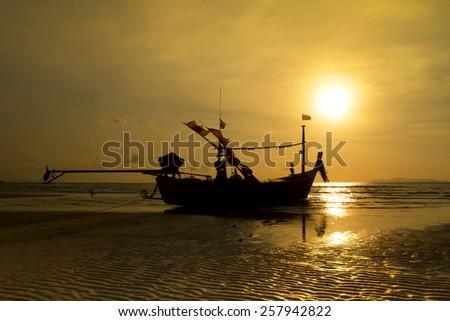 Fishing boat on Koh Samui at sunset, Nathon,Surat Thani - stock photo