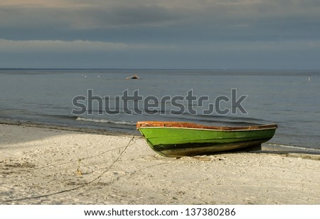 Fishing boat on sandy beach of Baltic Sea, Latvia, Europe - stock photo