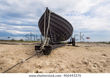 Fishing boat on shore of the Baltic Sea.